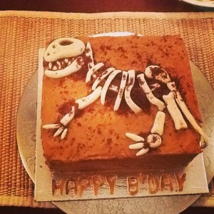 The cake was fresh mango and sprinkled with cocoa powder. The fossil was fondant.