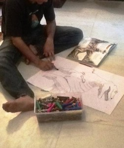 The T-rex being sketched by the OA. The Brat coloured it after his father was done.
