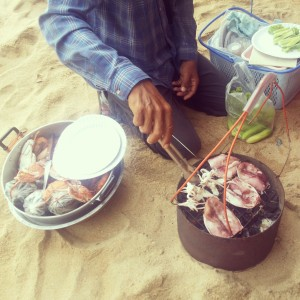 Grilling fresh seafood on the beach